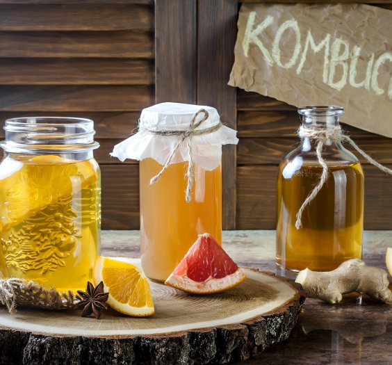 Homemade fermented raw kombucha tea with different flavorings. Healthy natural probiotic flavored drink.