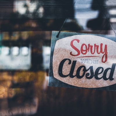 Sorry we're closed . grunge image hanging on a cafe window, Coronavirus COVID-19 outbreak lockdown.